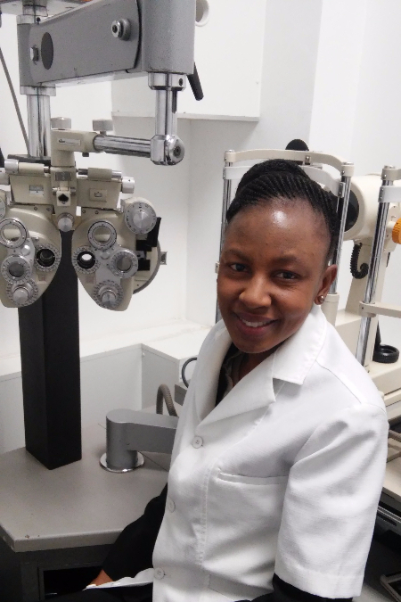 Optometrist Menki Mmathema in the testing room