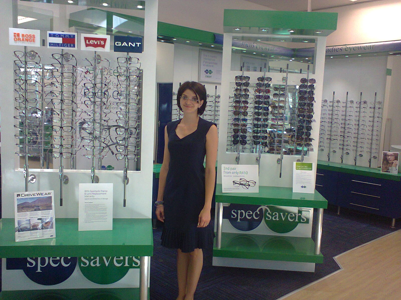 Maritza Engelbrecht standing by the collection's of frames