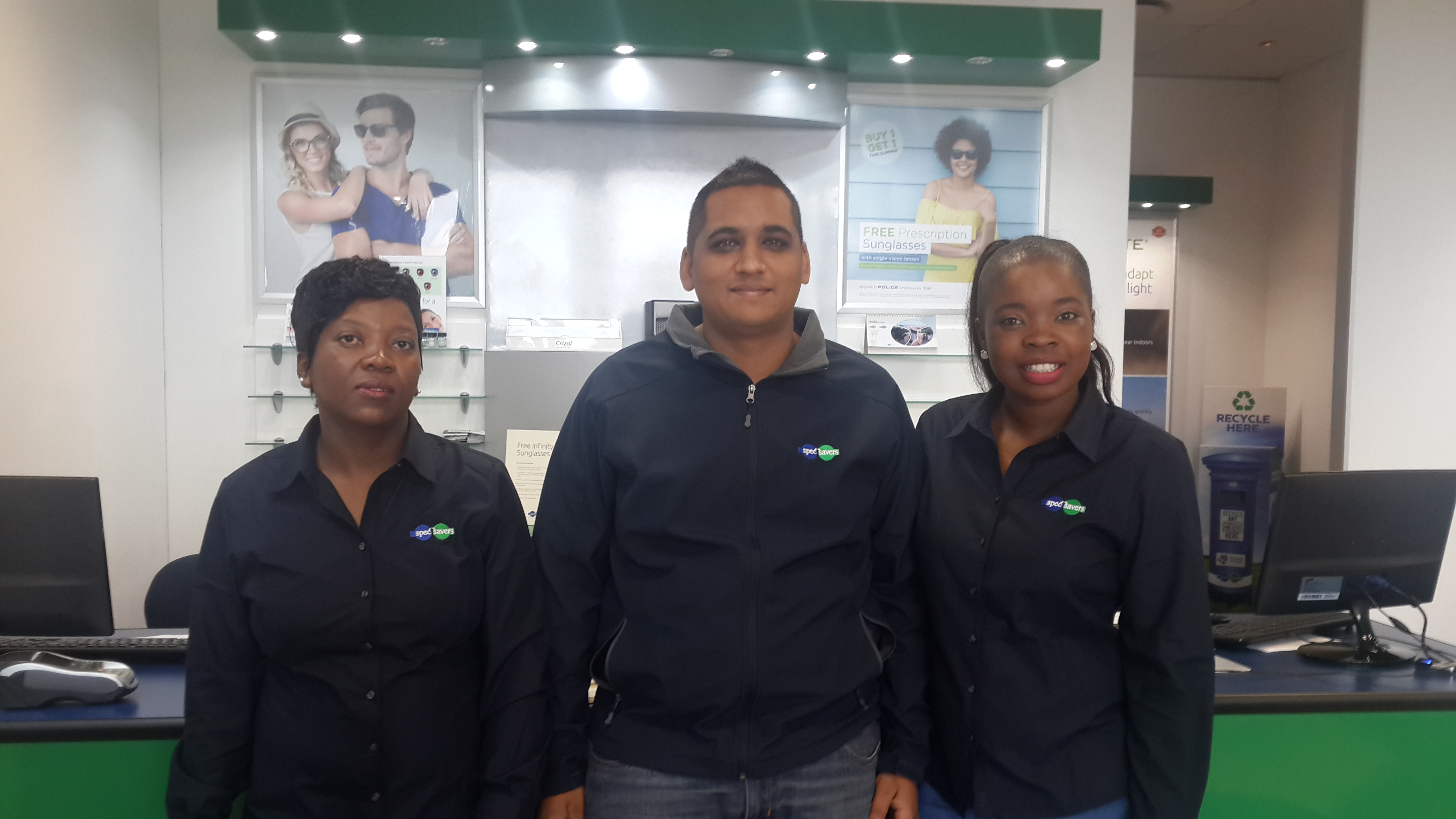 Optometrist Deeshan Rampathy with Nombulelo Mtwazi (left) and Cute Siweya (right)
