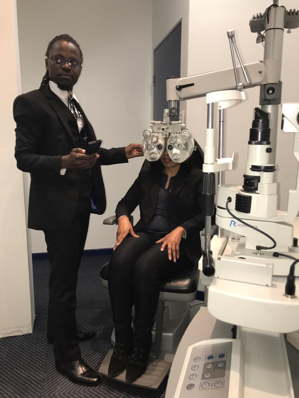 Optometrist Wiseman Mchabe examining a patient