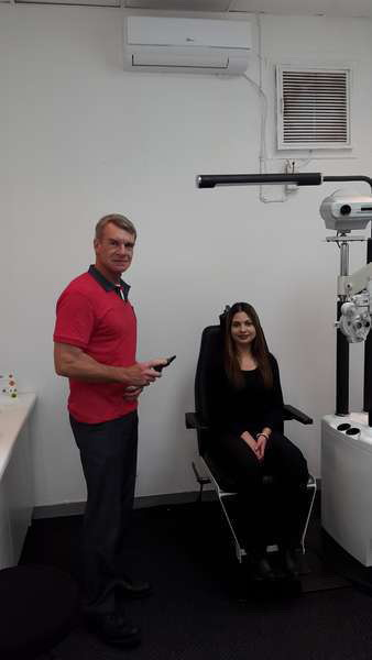 Optometrist Dave Parmee busy in the consulting room