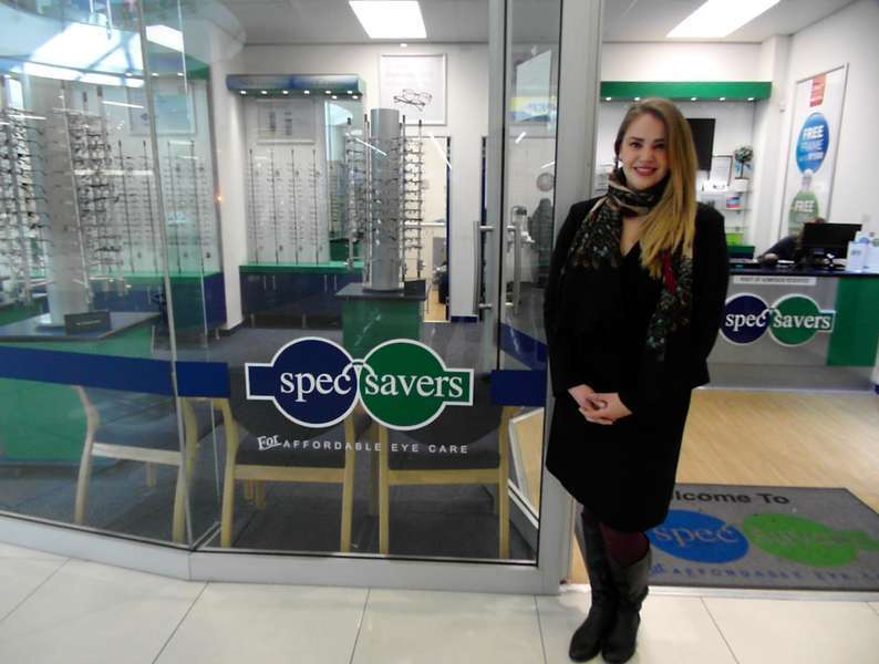 Optometrist Lize Goosen at the entrance of the practice