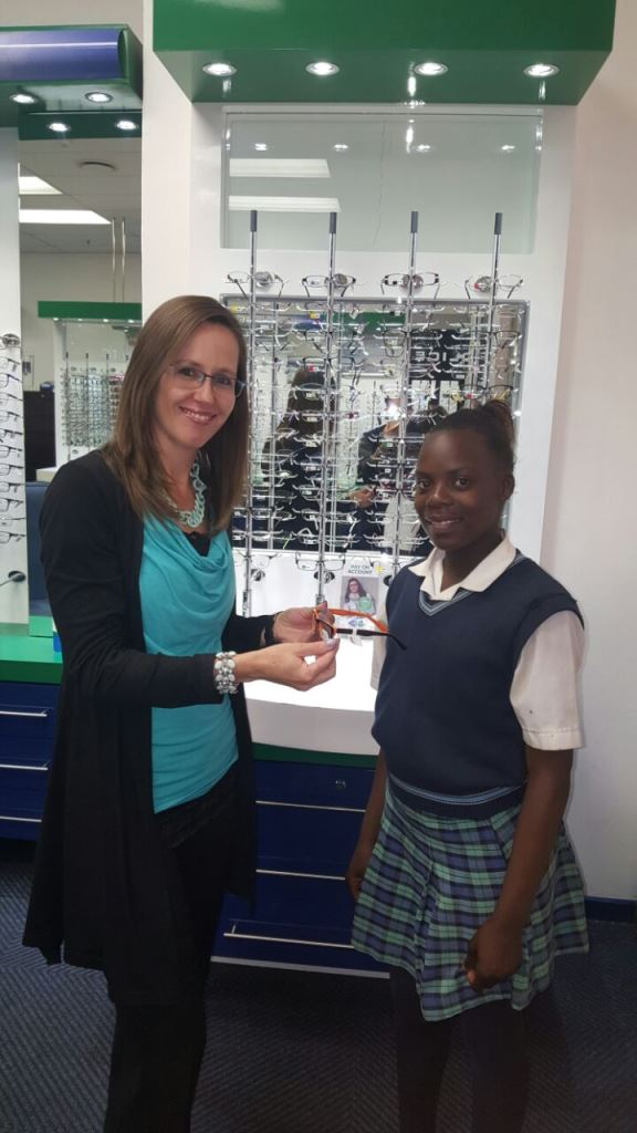 Optometrist, Jenny Sinclair with her patient