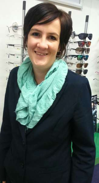 Genè Koen - Debtors department at Spec-Savers Festival Mall in Kempton Park CBD standing infront of the frame displays
