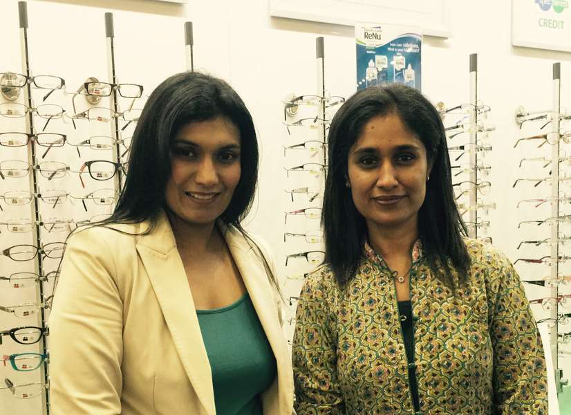 Optometrists: Desiree Naidoo (left) and Raksha Bhogal (right) in front of spectacle frame display