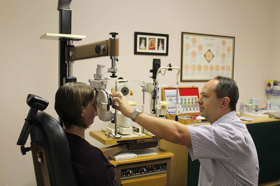 Optometrist Eugene Hildebrand busy with a refraction