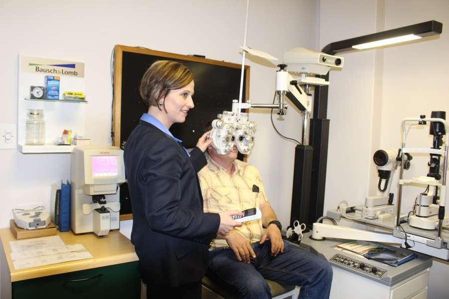 Optometrist Twanette Howell busy with refraction