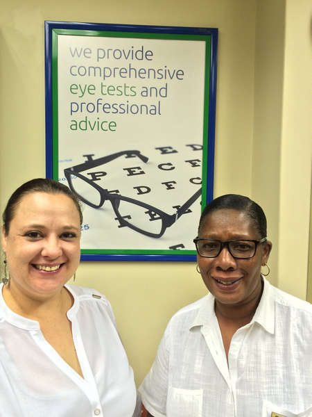 Practice Manager Annemarie Sandow with Frontliner Nomsa Shabangu in the reception area.