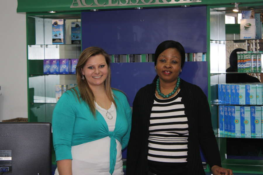 From left:  Megan Edwards and Thuli Dlamini at the front desk.