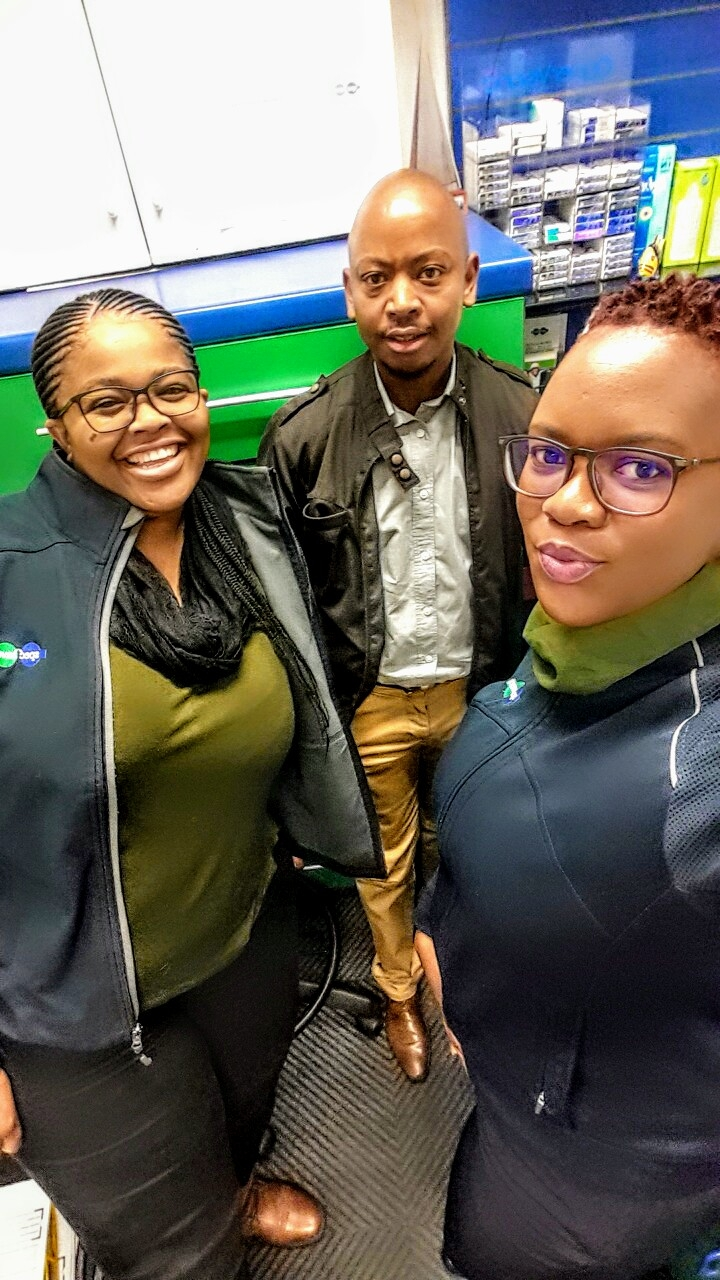 Justin Mokgatlhane (Optometrist) in the center, with Natasha and Debra on the left and right sides.