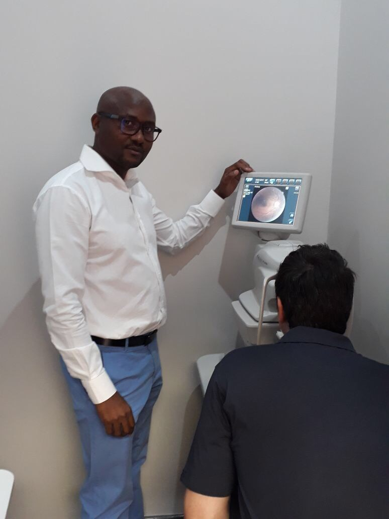 Optometrist Michael Kgopa using top of the art modern technology on one of our happy patients
