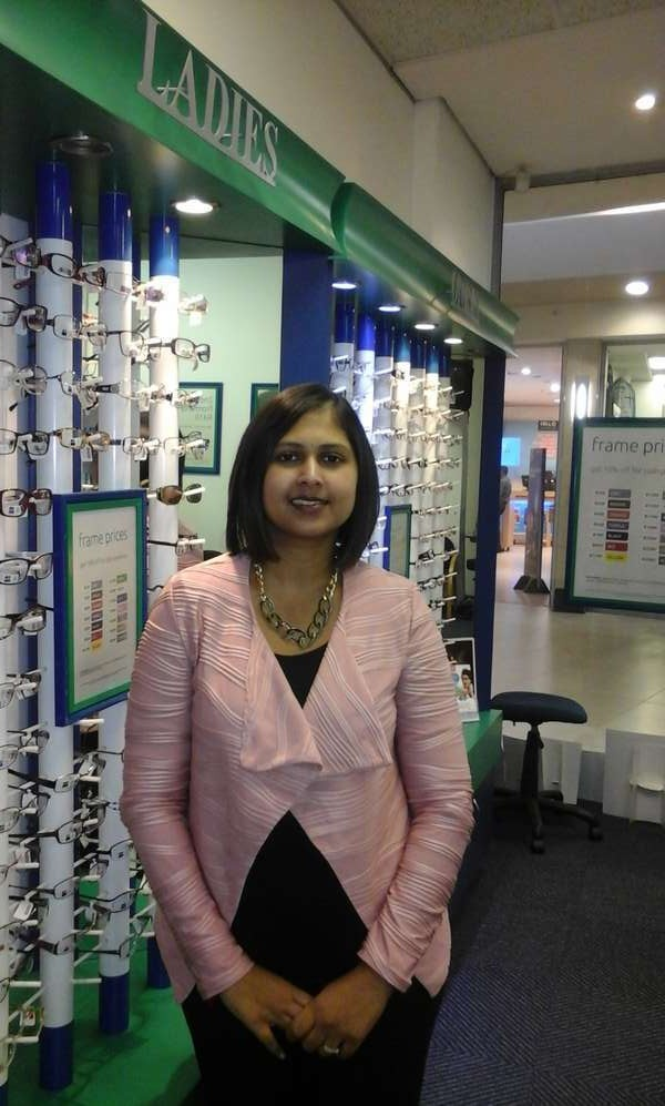 Optometrist Ronita Samdeo in front of the frame display