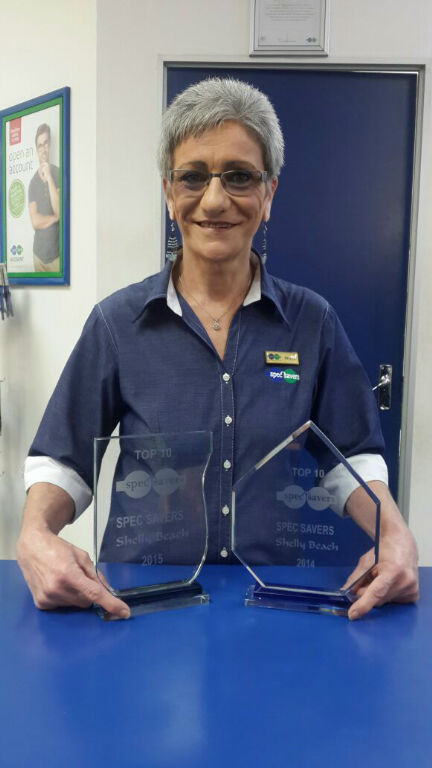 Brenda our store Manageress, showing our 2014 and 2015 Top Ten Rewards.