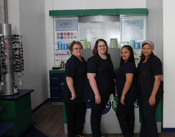 Frontliner: Natasha Potgieter, Debtors Clerk: Gwen Nel, Store Manager: Janine Malan and Optical Assistant: Zayyaan Hassiem at the reception desk